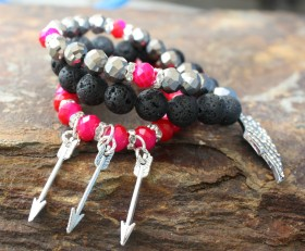 On A Wing And Arrows Beaded Bracelet Stack