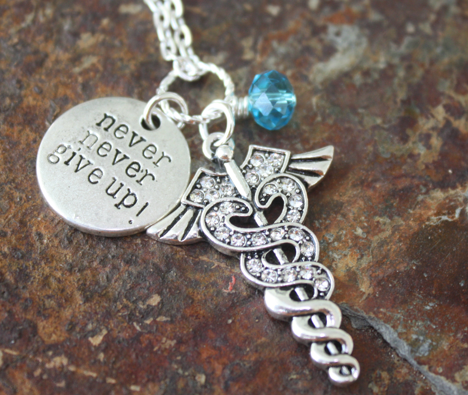 Never give up with caduceus blue laamb designs never give up with caduceus aloadofball Images