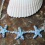 3 blue starfish